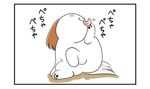 足を舐めるのに夢中な犬