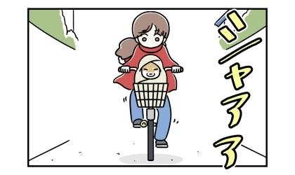自転車のかごには柴犬が乗っていた