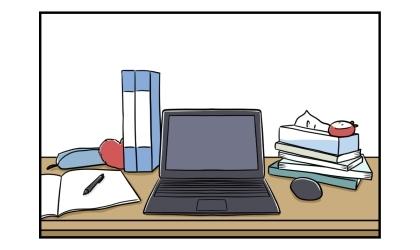 夫の仕事机の上。中央にパソコン、右手に本とティッシュの箱、左手にノートとファイル